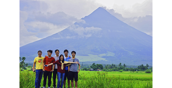 Left to right - Beam and Go Founder Jonathan Chua with the Fausto family Anton, Marvin, Enrique, Martin and the author posing by the majestic Mayon Volcano